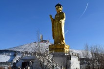 The Golden Buddha Statue with the Zaisan Monument in the background